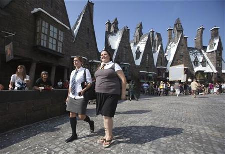 Guests tour the Wizarding World of Harry Potter theme park at the Universal Studio Resort during its grand opening in Orlando, June 18, 2010. REUTERS/Scott Audette