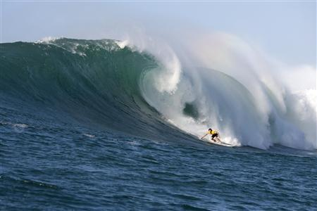 Hawaiian Greg Long surfs to win The Quiksilver In Memory Of Eddie Aikau big-wave surfing contest in this 2009 handout picture. REUTERS/Quiksilver/Handout