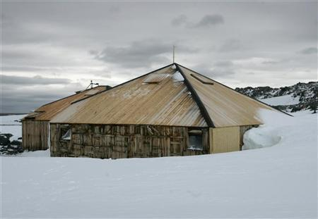 Mawson's Hut on Commonwealth Bay in Antarctica stands covered in snow in this undated file photo.  REUTERS/Pauline Askin/Files
