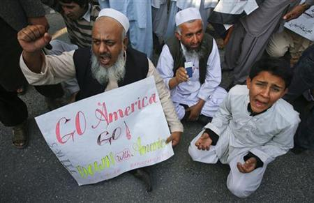 Supporters of Jamiat Ulema-e-Islam (JUI), a religious and political party, shout anti-America slogans during a demonstration against a NATO cross-border attack, in Peshawar December 2, 2011. REUTERS/Khuram Parvez