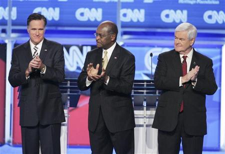 U.S. Republican presidential candidates (L-R) former Massachusetts Governor Mitt Romney, businessman Herman Cain, and former U.S. House Speaker Newt Gingrich (R-GA), take the stage at the start of the CNN GOP National Security debate in Washington, November 22, 2011.  REUTERS/Jonathan Ernst