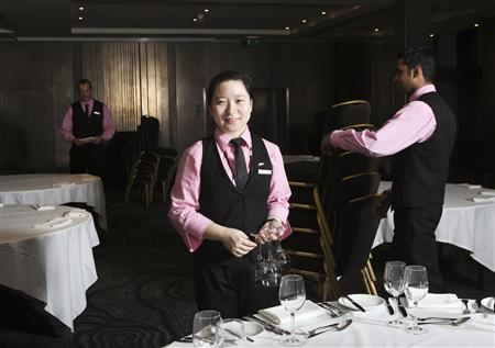 Shan Jie poses for a portrait at her workplace, the Bloomsbury Radisson hotel in London November 24, 2011.  Picture taken November 24, 2011.  REUTERS/Olivia Harris