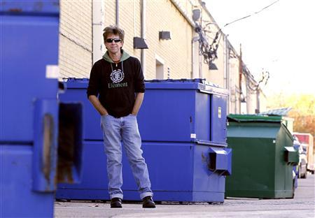 Jeff Ferrell, a professor of sociology at Texas Christian University, is pictured next to a trash dumpster in Fort Worth, Texas November 30, 2011.  REUTERS/Mike Stone