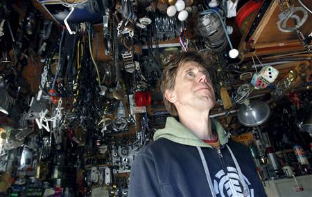 Jeff Ferrell, a professor of sociology at Texas Christian University, is pictured in his shop where he has organized thousands of useful but discarded items he has collected from dumpsters in Fort Worth,Texas November 30, 2011.  REUTERS/Mike Stone