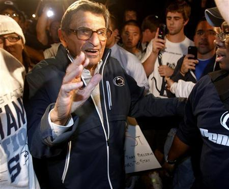 Penn State University football coach Joe Paterno walks to his residence after speaking to a group of students rallying outside it in State College, Pennsylvania, November 8, 2011.  REUTERS/Tim Shaffer