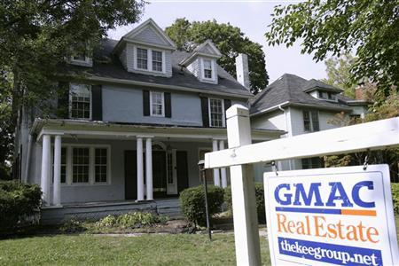 A view of a five-bedroom and two-bath home with a GMAC real estate sign in Detroit, Michigan September 23, 2007.   REUTERS/Rebecca Cook