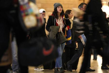 Travelers make their way to trains in Grand Central Station, New York November 22, 2011. REUTERS/Mike Segar