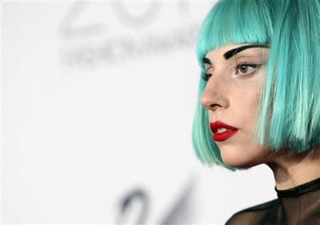 Lady Gaga looks on on the red carpet at the CFDA Fashion awards at the Lincoln Center's Alice Tully Hall in New York, June 6, 2011. REUTERS/Andrew Kelly