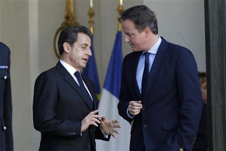 France's President Nicolas Sarkozy and Britain's Prime Minister David Cameron speak together after a working lunch at the Elysee Palace in Paris, December 2, 2011.  REUTERS/John Schults