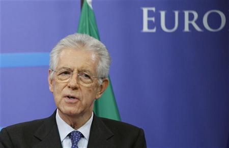 Italy's Prime Minister Mario Monti addresses a news conference after meeting European Council President Herman Van Rompuy at the EU Council in Brussels November 22, 2011. REUTERS/Francois Lenoir