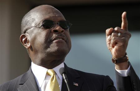 Herman Cain gestures as he announces that he is ''suspending'' his Republican presidential campaign at his Georgia campaign headquarters in Atlanta, Georgia December 3, 2011. REUTERS/John Adkisson