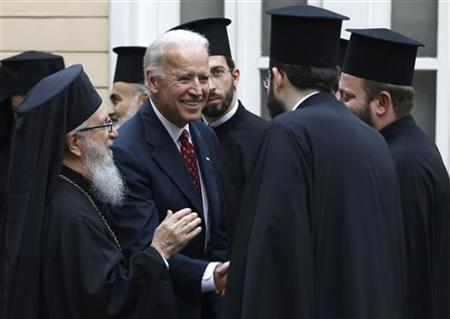 U.S. Vice President Joe Biden, accompanied by Archbishop Demetrios (L), Primate of the Greek Orthodox Church in America, is greeted by Orthodox priests upon his arrival at the Greek Orthodox Patriarchate in Istanbul December 3, 2011. REUTERS/Murad Sezer
