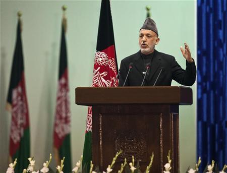 Afghan President Hamid Karzai speaks as he inaugurates Loya Jirga, grand assembly in Kabul November 16, 2011.   REUTERS/Ahmad Masood