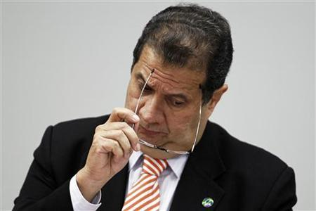 Brazil's Labor Minister Carlos Lupi reacts as he talks about allegations of irregularities in Ministry's of Labor during a meeting of the Commission for Financial Supervision and Control of the Chamber of Deputies in Brasilia November 10, 2011. REUTERS/Ueslei Marcelino/Files