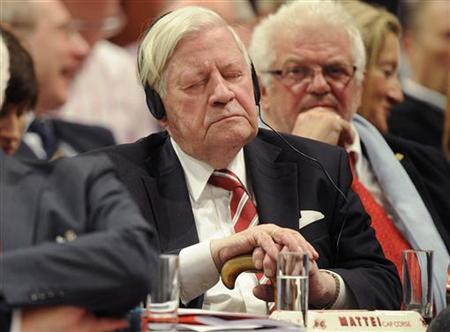 Former German Chancellor Helmut Schmidt of the Social Democratic Party (SPD) closes his eyes as he listens to a speech at SPD party convention in Berlin, December 4, 2011 REUTERS/Fabian Bimmer