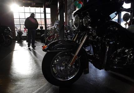 A potential customer looks at the motorcycles on display at the Boston Harley Davidson dealership in Everett, Massachusetts December 3, 2011.     REUTERS/Brian Snyder