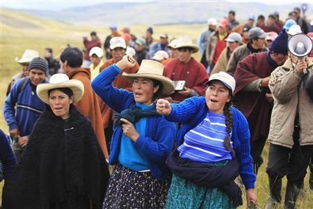 Andean people protest against Newmont Mining's Conga gold project during a march near the Cortada lagoon at Peru's region of Cajamarca, November 24, 2011. REUTERS/Enrique Castro-Mendivil