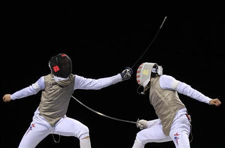 USA's Race Imboden (L) and USA's Gerek Meinhardt compete during the semi-finals of the Men's Individual Foil Fencing competition for an LOCOG Olympic test event at the Excel centre in London on November 26, 2011 REUTERS/Olivia Harris