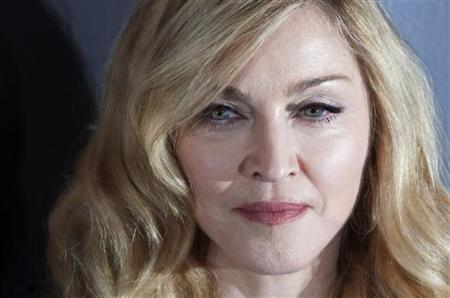 Director Madonna arrives at the screening of her film ''W.E.'' in New York, December 4, 2011.     REUTERS/Carlo Allegri (