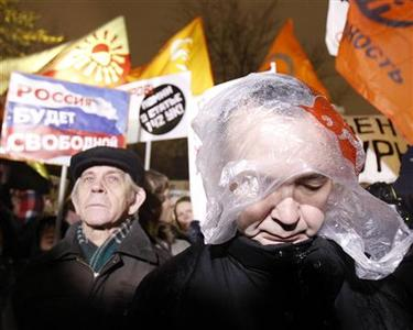 Participants hold placards during an opposition protest in central Moscow December 5, 2011.   REUTERS/Sergei Karpukhin