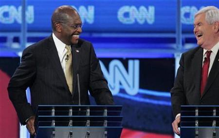 Herman Cain (L) and Newt Gingrich share a laugh during the CNN GOP National Security debate in Washington, November 22, 2011.  REUTERS/Jonathan Ernst