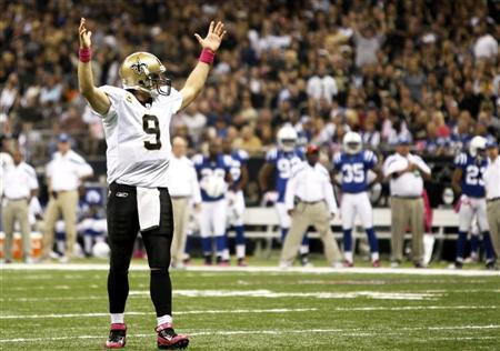 New Orleans Saints quarterback Drew Brees celebrates after his team scored a touchdown against the Indianapolis Colts during their NFL game at the Mercedes-Benz Superdome in New Orleans, Louisiana October 23, 2011. REUTERS/Sean Gardner