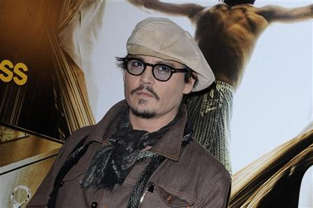 Johnny Depp poses for photographers during a photocall for the film ''The Rum Diary'' in Paris November 8, 2011. REUTERS/Gonzalo Fuentes