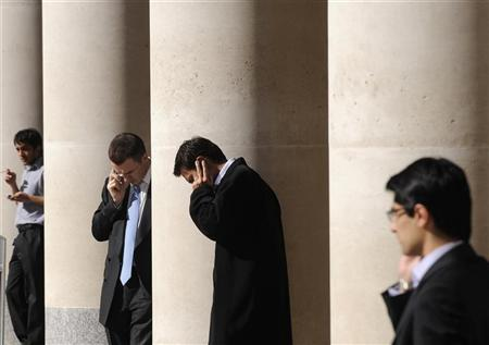 City workers make phone calls outside the London Stock Exchange in Paternoster Square in the City of London at lunchtime October 1, 2008. REUTERS/Toby Melville