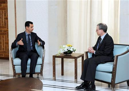 New U.S. ambassador Robert Ford (R) talks with Syria's President Bashar al-Assad after presenting his credentials to Assad, in Damascus January 27, 2011.  REUTERS/Sana