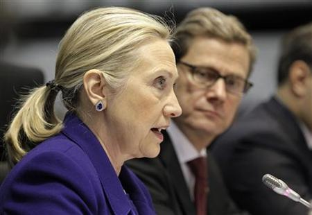 U.S. Secretary of State Hillary Rodham Clinton, joined at right by German Foreign Minister Guido Westerwelle, speaks during an international conference of the Organization for Security and Cooperation in Europe (OSCE), in Vilnius December 6, 2011. REUTERS/J. Scott Applewhite/Pool