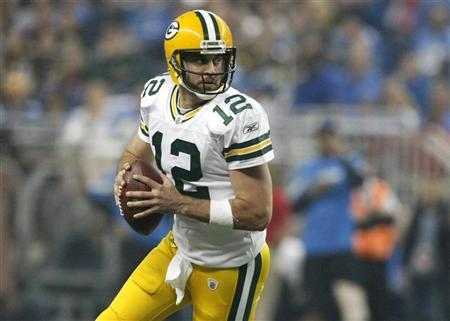 Green Bay Packers quarterback Aaron Rodgers  looks for his receiver during the second half of their NFL football game against the Detroit Lions in Detroit, Michigan November 24, 2011.   REUTERS/Rebecca Cook