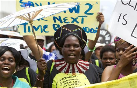Environmental activists demonstrate outside the United Nations Climate Change conference (COP17) in Durban December 3, 2011. The protest march was part of a Global Day of Action to demand a fair climate change deal.   REUTERS/Rogan Ward (SOUTH AFRICA - Tags: ENVIRONMENT)