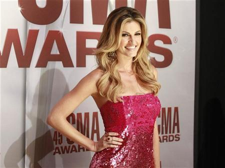 Sportscaster Erin Andrews arrives at the 45th Country Music Association Awards in Nashville, Tennessee, November 9, 2011. REUTERS/Harrison McClary