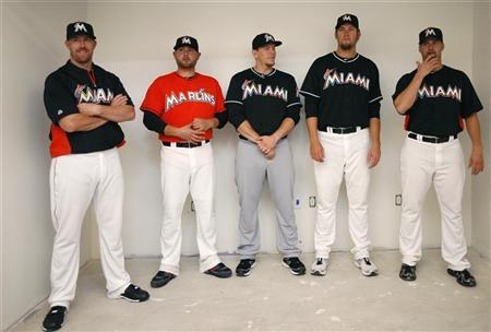 Members of the Florida Marlins wait to be interviewed after announcing their new uniforms for the upcoming baseball season at a premiere event in Miami, Florida November 11, 2011. REUTERS/Andrew Innerarity