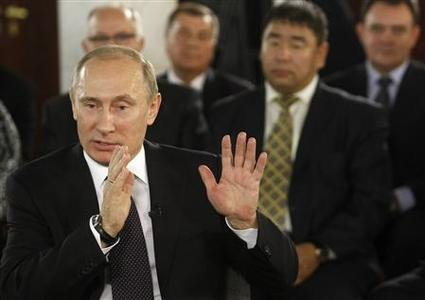 Russia's Prime Minister Vladimir Putin meets with regional leaders of public offices of United Russia party in Moscow, December 6, 2011.  REUTERS/Sergei Karpukhin