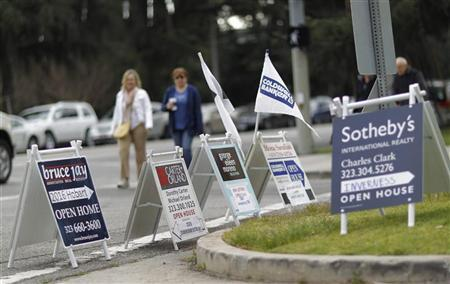 Signs advertising open houses for real estate sale are seen in Los Angeles March 6, 2011.  REUTERS/Mario Anzuoni