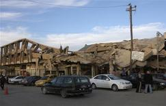 <p>A building that collapsed during a battle is seen in Falluja city, 50 km (31 miles) west of Baghdad December 5, 2011. REUTERS/Mohanned Faisal</p>
