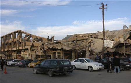A building that collapsed during a battle is seen in Falluja city, 50 km (31 miles) west of Baghdad December 5, 2011.  REUTERS/Mohanned Faisal