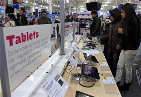 Shoppers look at tablet computers at a Best Buy Store on the shopping day dubbed ''Black Friday'' in Framingham, Massachusetts November 25, 2011. REUTERS/Adam Hunger