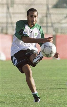 Saadi Gaddafi, son of Muammar Gaddafi, kicks the ball during his team Al-Ahli's training session in Hamrun outside Valletta, in this June 6, 2000 file photo. REUTERS/Darrin Zammit Lupi/Files