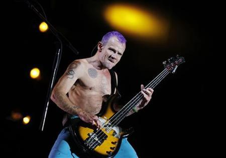 Red Hot Chili Peppers bassist Michael ''Flea'' Balzary performs during their world tour at the National Stadium in Lima, September 14, 2011. REUTERS/Enrique Castro-Mendivil