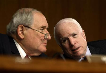 Carl Levin (L)(D-MI) and John McCain (R-AZ) confer during the confirmation hearing of U.S. Army General Martin Dempsey for Chairman of the Joint Chiefs of Staff, on Capitol Hill in Washington, in this July 26, 2011 file photo. REUTERS/Jason Reed