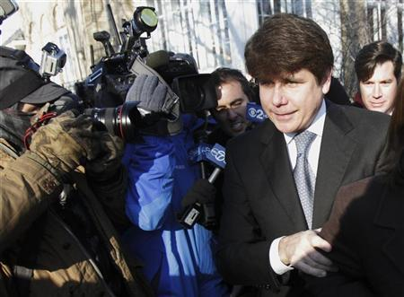 Disgraced former Illinois Governor Rod Blagojevich leaves his home in Chicago home for the second day of his sentencing hearing December 7, 2011. REUTERS/John Gress