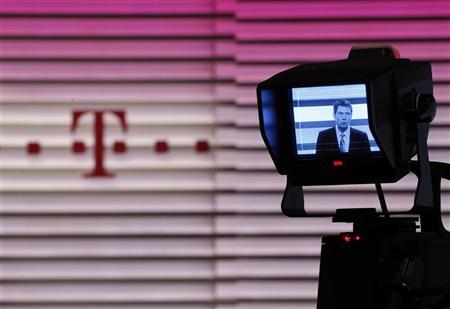CEO of Deutsche Telekom Rene Obermann is seen on a camera display during the annual news conference in Bonn February 25, 2011.  REUTERS/Ina Fassbender