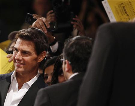 U.S. actor Tom Cruise poses with fans as he arrives at the opening ceremony of the 8th Dubai International Film Festival for the premiere of his new movie ''Mission Impossible: Ghost Protocol'' December 7, 2011, REUTERS/Jumana El Heloueh