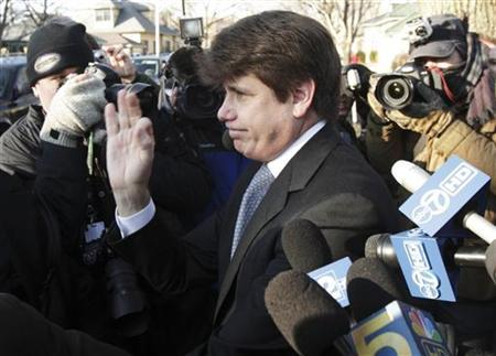Disgraced former Illinois Governor Rod Blagojevich leaves his Chicago home for the second day of his sentencing hearing December 7, 2011. REUTERS/John Gress