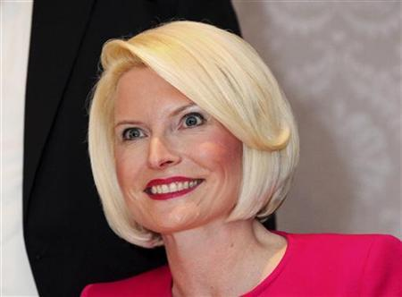 Callista Gingrich, wife of Republican presidential candidate Newt Gingrich, poses for supporters as she signs copies of her book ''Sweet Land of Liberty'' at a signing event November 28, 2011, at the Sottile Theatre on the campus of the College of Charleston. REUTERS/Randall Hill/Files