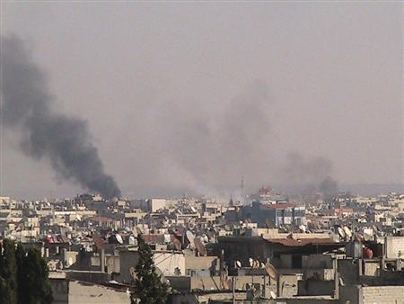 Smoke rises from the city of Homs, December 4, 2011.  REUTERS/Handout