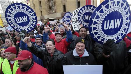 United Auto Workers convention delegates chant during a rally for good jobs and tax reform following a UAW convention in Detroit, Michigan, in this March 24, 2011 file photo. REUTERS/Rebecca Cook