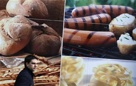 A man walks past a grocery store in downtown Sofia November 14, 2011. REUTERS/Stoyan Nenov